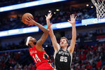 New Orleans Pelicans forward Brandon Ingram (14) shoots against San Antonio Spurs center Jakob Poeltl (25) in the first half of an NBA basketball game in New Orleans, Wednesday, Jan. 22, 2020. (AP Photo/Gerald Herbert)