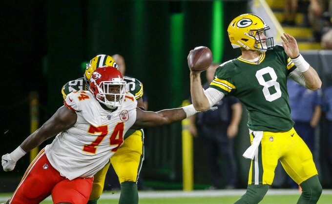 Green Bay Packers' Tim Boyle throws with Kansas City Chiefs' Justin Hamilton rushing during the first half of a preseason NFL football game Thursday, Aug. 29, 2019, in Green Bay, Wis. (AP Photo/Mike Roemer)