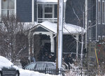 Police leave a home after breaching it on Oakland Avenue South, Sunday, Dec. 1, 2019, in Minneapolis. Two boys were found shot late Sunday morning outside the residence, where two adults were found dead later in the day. The two boys were also later pronounced dead, in what police are calling a