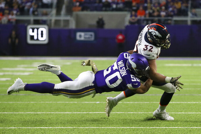 Denver Broncos fullback Andy Janovich (32) is tackled by Minnesota Vikings linebacker Eric Wilson (50) during the first half of an NFL football game, Sunday, Nov. 17, 2019, in Minneapolis. (AP Photo/Jim Mone)