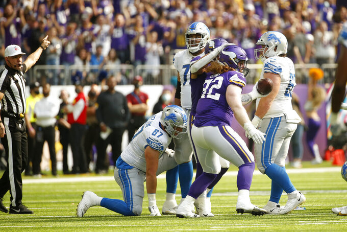 Minnesota Vikings defensive tackle James Lynch (92) celebrates after recovering a fumble during the first half of an NFL football game against the Detroit Lions, Sunday, Oct. 10, 2021, in Minneapolis. (AP Photo/Bruce Kluckhohn)