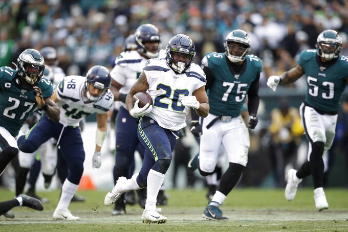 Seattle Seahawks' Rashaad Penny (20) runs for a touchdown during the second half of an NFL football game against the Philadelphia Eagles, Sunday, Nov. 24, 2019, in Philadelphia. (AP Photo/Matt Rourke)