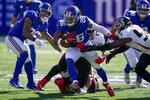 New York Giants running back Saquon Barkley (26) runs the ball past Atlanta Falcons linebacker Foye Oluokun, right, during the second half of an NFL football game, Sunday, Sept. 26, 2021, in East Rutherford, N.J. (AP Photo/Seth Wenig)