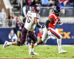 Mississippi defensive end Austrian Robinson (38) intercepts a pass as he is chased by Texas A&M offensive lineman Colton Prater (76) during the first half of an NCAA college football game, Saturday, Oct. 19, 2019 in Oxford, Miss. (Bruce Newman/The Oxford Eagle via AP)