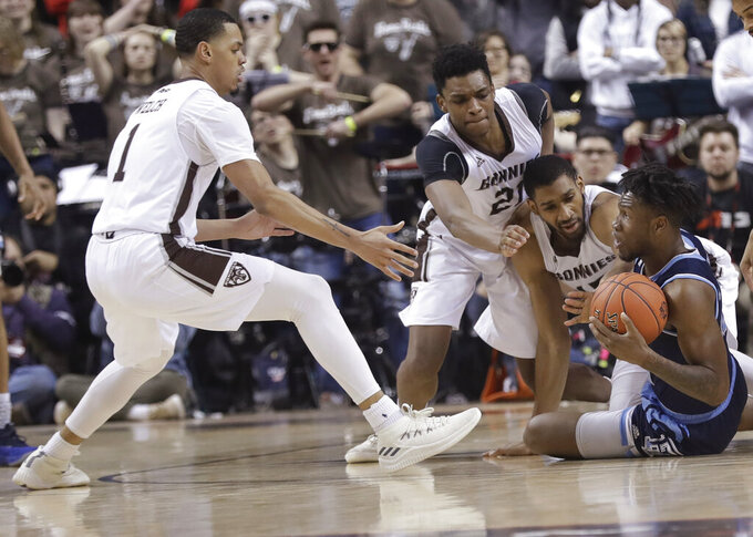 Rhode Island's Cyril Langevine, right, looks to pass as St. Bonaventure's Dominick Welch (1) and Osun Osunniyi (21) rush toward him during the second half of an NCAA college basketball game in the semifinal round of the Atlantic 10 men's tournament Saturday, March 16, 2019, in New York. St. Bonaventure won 68-51. (AP Photo)