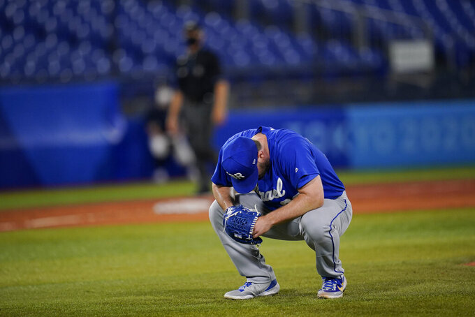 Israel's Jeremy Bleich reacts after hitting two South Korea batters in a row in the tenth inning of a baseball game at the 2020 Summer Olympics, Thursday, July 29, 2021, in Yokohama, Japan. South Korea Won 6-5.(AP Photo/Sue Ogrocki)