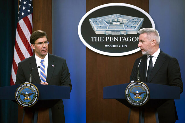 Secretary of Defense Mark Esper, left, and Italian Minister of Defense Lorenzo Guerini take part in a joint press conference on Friday, Jan. 31, 2020, at the Pentagon in Washington. (AP Photo/Kevin Wolf)