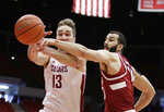 Washington State forward Jeff Pollard (13) and Stanford center Josh Sharma go after a rebound during the first half of an NCAA college basketball game in Pullman, Wash., Saturday, Jan. 19, 2019. (AP Photo/Young Kwak)