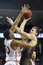 Lehigh center James Karnik shoots over Auburn center Austin Wiley (50) during the first half of an NCAA college basketball game Saturday, Dec. 21, 2019, in Auburn, Ala. (AP Photo/Julie Bennett)