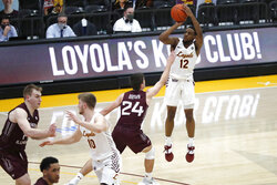Loyola of Chicago guard Marquise Kennedy (12) shoots a 3-point basket during the second half against Southern Illinois in an NCAA college basketball game Friday, Feb. 26, 2021, in Chicago. (AP Photo/Shafkat Anowar)