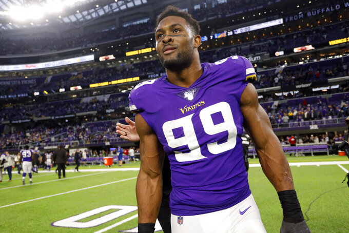 FILE - In this Sunday, Dec. 8, 2019 file photo, Minnesota Vikings defensive end Danielle Hunter walks off the field after an NFL football game against the Detroit Lions in Minneapolis. The Minnesota Vikings have placed defensive end Danielle Hunter on injured reserve. The move takes one of their most vital players out of action for the season opener against Green Bay and at least two more games after that. (AP Photo/Bruce Kluckhohn, File)