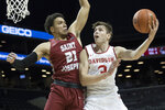 Davidson guard Jon Axel Gudmundsson (3) goes to the basket against Saint Joseph's forward Lorenzo Edwards (21) during the first half of an NCAA college basketball game in the Atlantic 10 Conference tournament, Friday, March 15, 2019, in New York. (AP Photo/Mary Altaffer)
