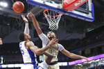 Georgia Tech's James Banks III (1) blocks a shot by Pittsburgh's Au'Diese Toney (5) during the first half of an NCAA college basketball game, Saturday, Feb. 8, 2020, in Pittsburgh. (AP Photo/Keith Srakocic)