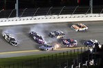 Aric Almirola (10), Alex Bowman (48) and Kaz Grala (16) get caught up in a crash coming out of Turn 4 as Kyle Larson (5), Cole Custer (41), Landon Cassill (96) and Joey Gase (15) try to avoid the wreck during the NASCAR Cup Series auto race at Daytona International Speedway, Saturday, Aug. 28, 2021, in Daytona Beach, Fla. (AP Photo/David Graham)