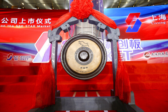 A special gong is prepared for the launch of the SSE STAR Market in the hall of Shanghai Securities Exchange in Shanghai, China, Monday, July 22, 2019. Trading started Monday on a Chinese stock market for high-tech companies that play a key role in official development plans that are straining relations with Washington. (Chinatopix via AP)
