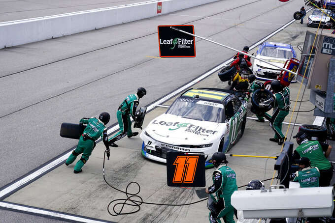 Justin Haley (11) takes a pit stop during a NASCAR Xfinity Series auto race Saturday, Sept. 5, 2020, in Darlington, S.C. (AP Photo/Chris Carlson)