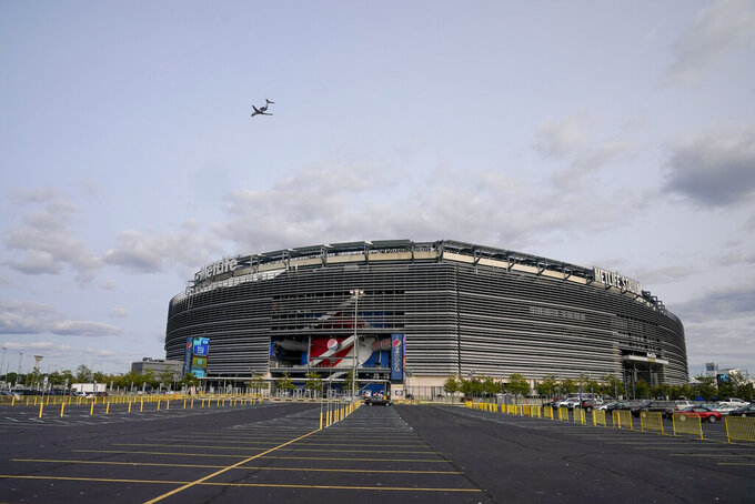 The parking lot outside Met Life Stadium sits empty before an NFL football game between the New York Giants and the Pittsburgh Steelers, Monday, Sept. 14, 2020, in East Rutherford, N.J. (AP Photo/Seth Wenig)
