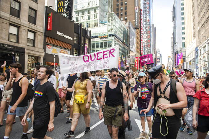 People gather and rally at the Queer Liberation March on Sunday, June 27, 2021, in New York. (AP Photo/Brittainy Newman)