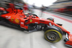 Ferrari driver Sebastian Vettel of Germany steers out of the garage during the first practice session of the Chinese Formula One Grand Prix at the Shanghai International Circuit in Shanghai on Friday, April 12, 2019. (AP Photo/Ng Han Guan)