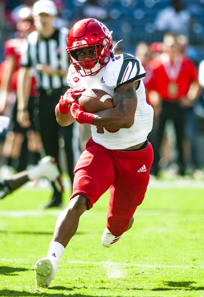 Louisville Cardinals running back Javian Hawkins (10) carries the ball during Louisville's 38-21 win over WKU on Saturday, Sept. 13, 2019, at Nissan Stadium. (Austin Anthony/Daily News via AP)