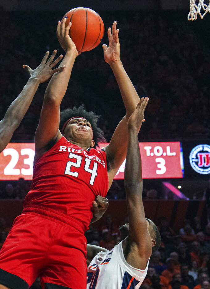 Rutgers forward Ron Harper Jr. (24) shoots over Illinois guard Da'Monte Williams (20) in the first half of an NCAA college basketball game in Champaign, Ill., Saturday, Feb. 9, 2019. (AP Photo/Robin Scholz)