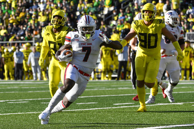Stony Brook running back Ty Son Lawton (7) cuts to the end zone to score during the first quarter of an NCAA college football game Saturday, Sept. 18, 2021, in Eugene, Ore. (AP Photo/Andy Nelson)