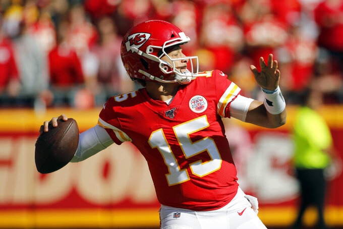 Kansas City Chiefs quarterback Patrick Mahomes (15) throws a pass during the first half of an NFL football game against the Houston Texans in Kansas City, Mo., Sunday, Oct. 13, 2019. (AP Photo/Colin E. Braley)00