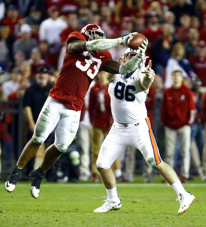 Alabama linebacker Anfernee Jennings (33) intercepts a pass intended for Auburn tight end Tucker Brown (86) during the second half of an NCAA college football game, Saturday, Nov. 24, 2018, in Tuscaloosa, Ala. (AP Photo/Butch Dill)