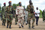 In this photo taken Wednesday, Aug. 28, 2019, opposition soldiers walk in formation during a visit by a ceasefire monitoring team, at an opposition military camp near the town of Nimule in Eastern Equatoria state, South Sudan. South Sudan's fragile peace deal is faltering Wednesday Oct. 16, 2019, less than one month before the country's president and armed opposition leader are meant to form a unity government and begin the long recovery from a five-year civil war. (AP Photo/Sam Mednick)