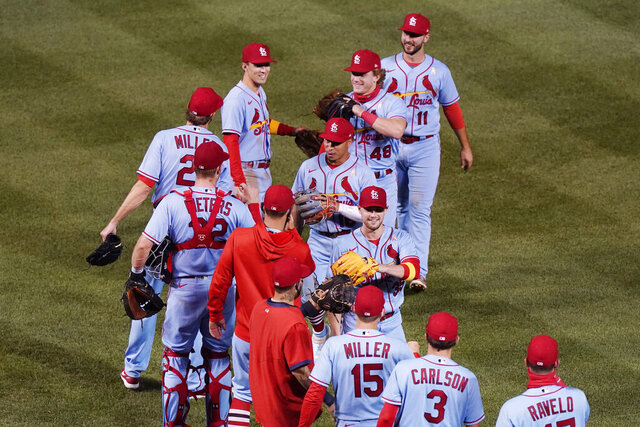 St. Louis Cardinals players celebrate after they defeated the Chicago Cubs in the second baseball game of a doubleheader in Chicago, Saturday, Sept. 5, 2020. (AP Photo/Nam Y. Huh)