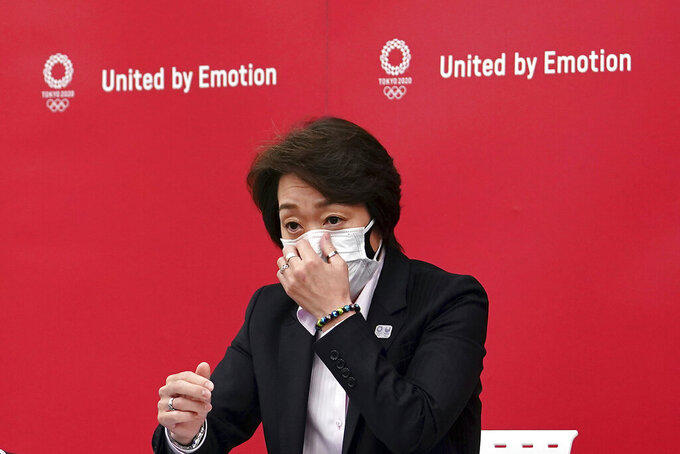 Seiko Hashimoto, president of the Tokyo 2020 Organizing Committee of the Olympic and Paralympic Games (Tokyo 2020), speaks during a news conference Thursday, March 11, 2021, after attending the International Olympic Committee (IOC) general meeting. (AP Photo/Eugene Hoshiko, Pool)