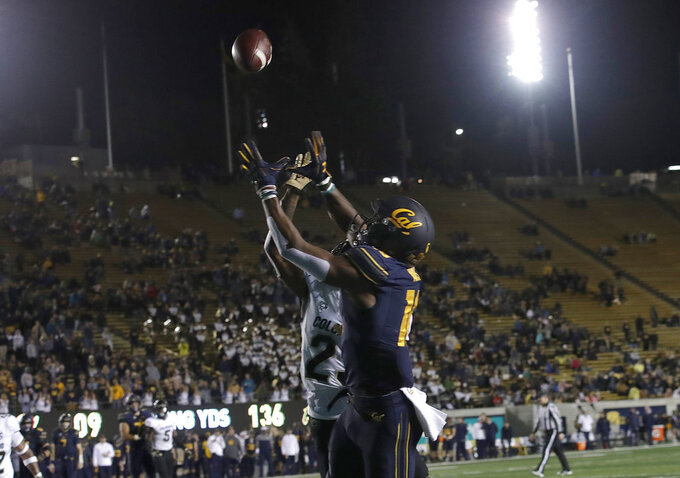 California wide receiver Maurice Ways, foreground, catches a touchdown pass over Colorado cornerback Mekhi Blackmon during the second half of an NCAA college football game in Berkeley, Calif., Saturday, Nov. 24, 2018. California won, 33-21. (AP Photo/Jeff Chiu)