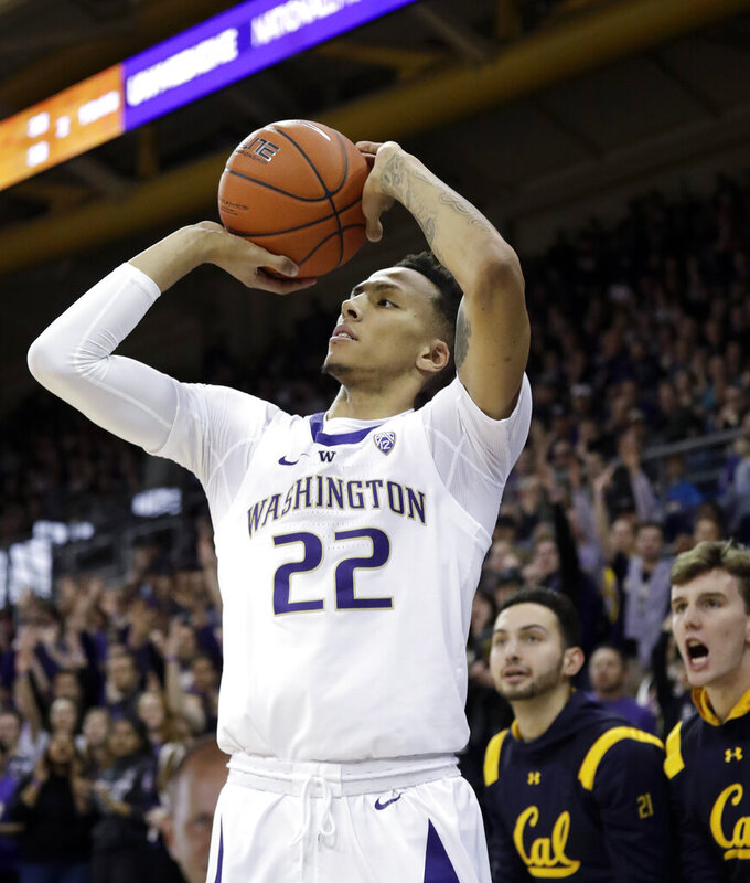 Washington's Dominic Green puts up a shot in front of California's bench in the first half of an NCAA college basketball game Saturday, Jan. 19, 2019, in Seattle. (AP Photo/Elaine Thompson)