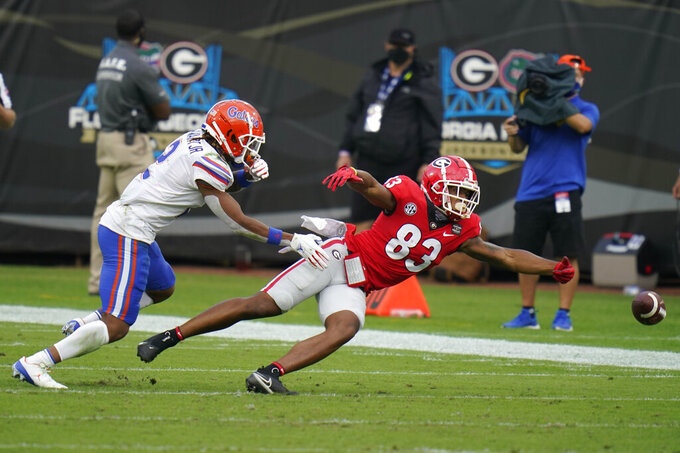 Georgia wide receiver Kaustov Chakrabarti (83) can't make the catch on a pass play as Florida defensive back Brad Stewart Jr., left, defends during the first half of an NCAA college football game, Saturday, Nov. 7, 2020, in Jacksonville, Fla. (AP Photo/John Raoux)