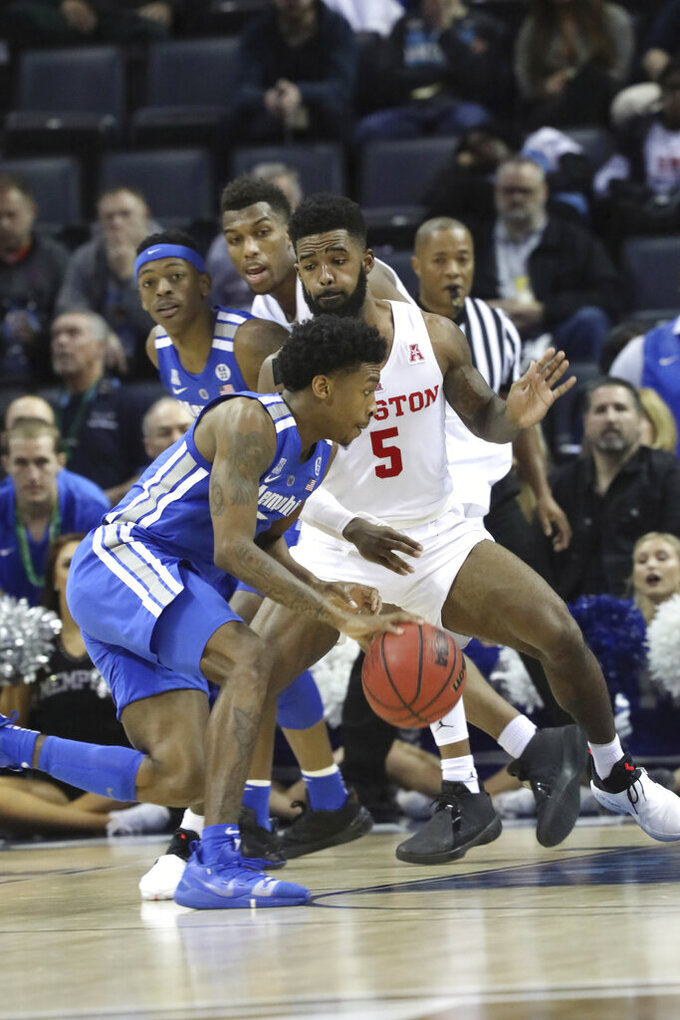 Memphis player Kareem Brewton pushes inside while defended by Houston's Corey Davis Jr. in the second half of an NCAA college basketball game at the American Athletic Conference tournament Saturday, March 16, 2019, in Memphis, Tenn. (AP Photo/Troy Glasgow)