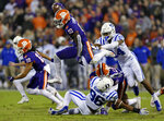 "FILE - In this Nov. 17, 2018, file photo, Clemson's Derion Kendrick (10) hurdles Duke's Chris Rumph ll (96) on a kickoff return as Jarrett Garner reaches for him during the first half of an NCAA college football game in Clemson, S.C. Sure, Clemson lost all four of its ""Power Rangers"" defensive line and seven starters on defense from its title team. But the Tigers' offense, led by Heisman Trophy candidates quarterback Trevor Lawrence and tailback Travis Etienne, looks ready to operate at an even higher level than a year ago when it averaged 527 yards and 44.3 points a game. (AP Photo/Richard Shiro, File)"
