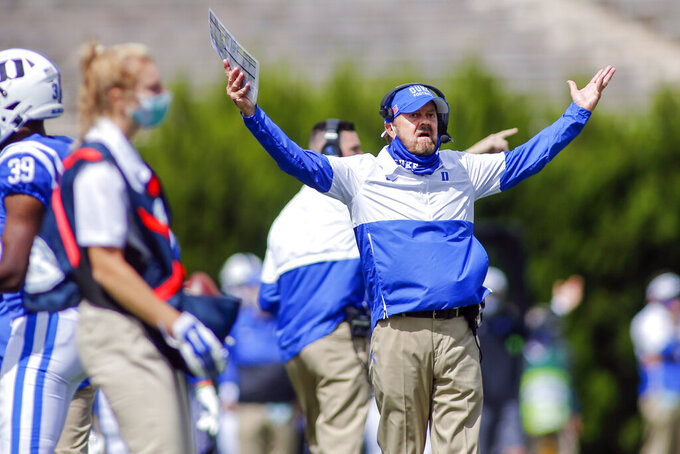 Duke head coach David Cutcliffe reacts after his team was called for a penalty during the first half of an NCAA college football game against Boston College, Saturday, Sept. 19, 2020, in Durham, N.C. (Nell Redmond/Pool Photo via AP)