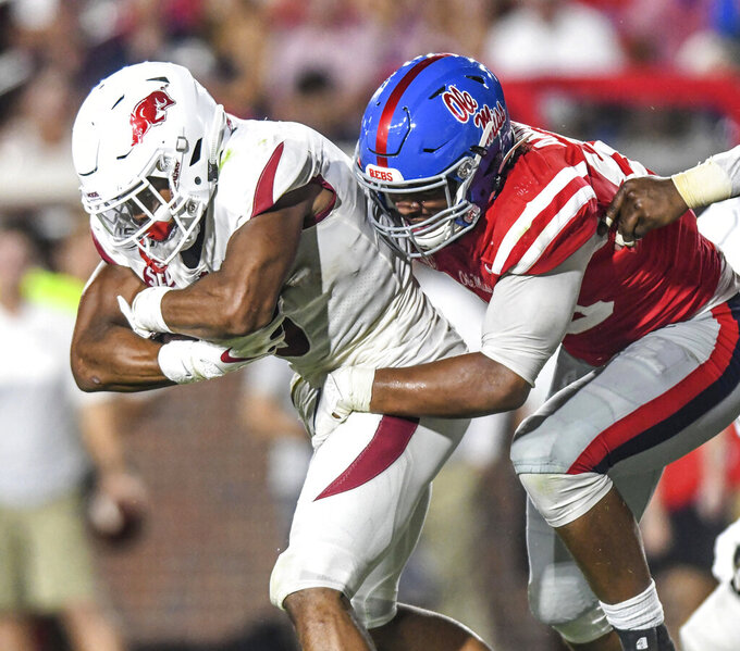 Arkansas wide receiver Shamar Nash (4) is tackled by Mississippi defensive end Ryder Anderson (89) during an NCAA college football game Saturday, Sept. 7, 2019, in Oxford, Miss. (Bruce Newman/The Oxford Eagle via AP)