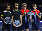 Pierre-Hugues Herbert of France, right, and Nicholas Mahut of France, second right, pose for the media with their winners trophy as Raven Klaasen of South Africa, left, and Michael Venus of New Zealand who hold their runners up plates as the pose for photographs, following their ATP World Finals final doubles tennis match at the O2 arena in London, Sunday, Nov. 17, 2019. (AP Photo/Kirsty Wigglesworth)