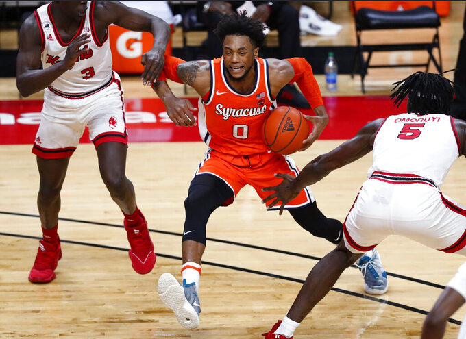 Syracuse forward Alan Griffin (0) drives to the basket between Rutgers forward Mawot Mag (3) and center Cliff Omoruyi (5) during the first half of an NCAA college basketball game in Piscataway, N.J., Tuesday, Dec. 8, 2020. (AP Photo/Noah K. Murray)