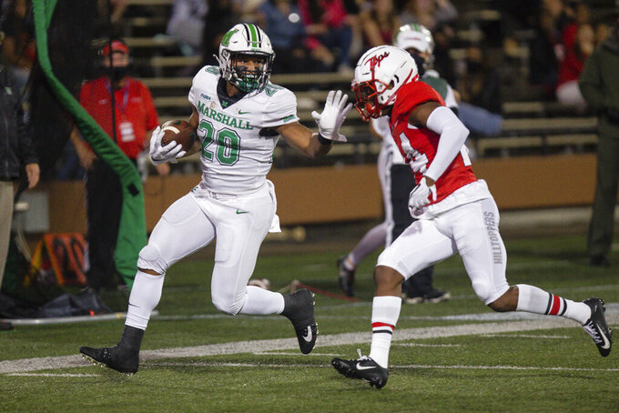 Marshall running back Brenden Knox rushes upfield on a carry against Western Kentucky during an NCAA college football game Saturday, Oct. 10, 2020, in Huntington, W.Va. (Sholten Singer/The Herald-Dispatch via AP)