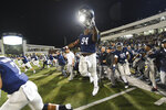 Georgia Southern running back C.J. Wright (94) celebrates as he and his team rush the field after an NCAA college football game against Appalachian State, Thursday, Oct. 25, 2018, in Statesboro, Ga. Georgia Southern won 34-14. (AP Photo/John Amis)