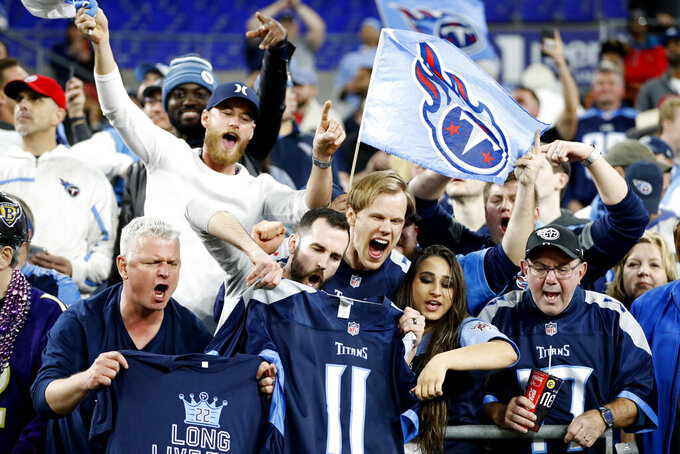 Tennessee Titans fans cheer after an NFL divisional playoff football game against Baltimore Ravens, Saturday, Jan. 11, 2020, in Baltimore. The Titans won 28-12. (AP Photo/Julio Cortez)