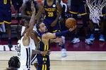 Indiana Pacers' Duane Washington Jr. shoots around Portland Trail Blazers' Michael Beasley during the first half of an NBA summer league basketball game Thursday, Aug. 12, 2021, in Las Vegas. (AP Photo/John Locher)