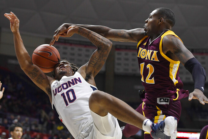 Iona's Tajuan Agee, right, fouls Connecticut's Brendan Adams, left, in the second half of an NCAA college basketball game, Wednesday, Dec. 4, 2019, in Storrs, Conn. (AP Photo/Jessica Hill)