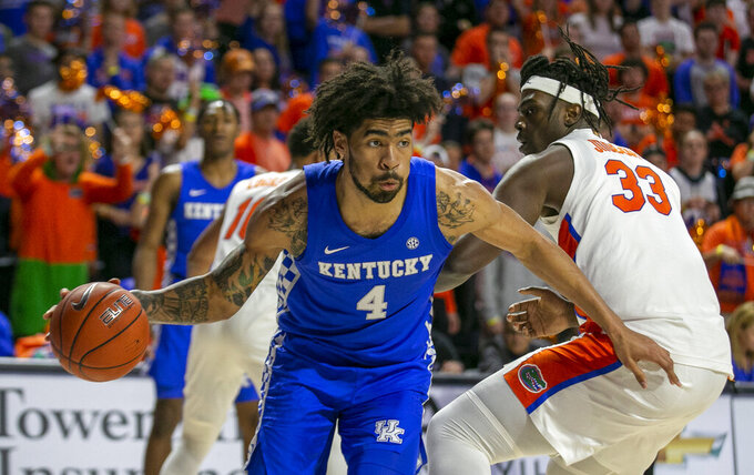 Kentucky forward Nick Richards (4) drives during the second half of an NCAA college basketball game against Florida Saturday, March 7, 2020, in Gainesville, Fla. (AP Photo/Alan Youngblood)