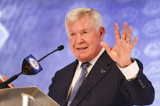 North Carolina head coach Mack Brown answers a question during the NCAA college football Atlantic Coast Conference media days in Charlotte, N.C., Wednesday, July 21, 2021. (AP Photo/Nell Redmond)