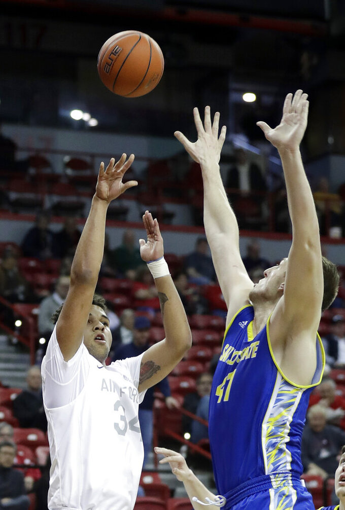 San Jose State's Ashtin Chastain defends a shot from Air Force's Ryan Swan (34) during the first half of an NCAA college basketball game in the Mountain West Conference men's tournament Wednesday, March 13, 2019, in Las Vegas. (AP Photo/Isaac Brekken)