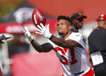 """FILE - In this July 25, 2019, file photo, Atlanta Falcons free safety Ricardo Allen tosses a ball in the air during the NFL football team's training camp in Flowery Branch, Ga. When Deion Jones, Allen and Keanu Neal take the field for Sunday's season opener at Minnesota, they'll be eager to show just what this team was missing when three of its defensive standouts went down with serious injuries. """"Everybody can say they've got the best team in the world right now,"""" Allen said. """"But we know who we are. We know what we've done together. If we can pull it together, if we can stay healthy and play together, the sky's the limit."""" (AP Photo/John Bazemore, File)"""