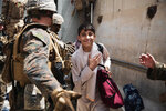 FILE - In this Wednesday, Aug. 18, 2021 file photo provided by the U.S. Marine Corps, a boy is processed through an Evacuee Control Checkpoint during an evacuation at Hamid Karzai International Airport, in Kabul, Afghanistan. (Staff Sgt. Victor Mancilla/U.S. Marine Corps via AP, File)